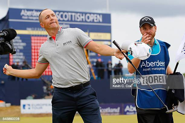 Alex Noren of Sweden throws his ball to the crowd after claiming victory on the 18th green during the final round of the AAM Scottish Open at Castle...