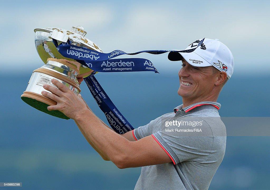 alex noren of sweden winner of the aberdeen asset management scottish open lifts the trophy at - Open Castle 2016