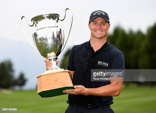 Alex Noren of Sweden with the winners trophy after his play off victory during the final round of the Omega European Masters at CranssurSierre Golf...