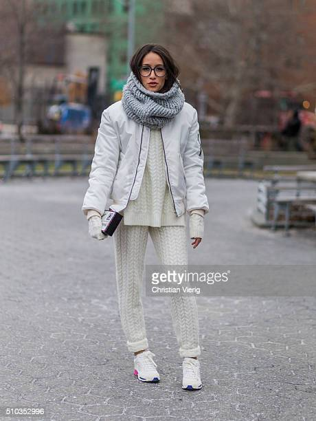 Alex of Alexs Cloest wearing a creme knitwear suit and a white bomber jacket and sneaker seen outside Lacoste during New York Fashion Week Women's...