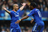 Alex of Chelsea celebrates with fellow goalscorer Didier Drogba after scoring during the Barclays Premier League match between Chelsea and Arsenal at...