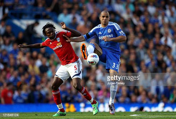 Alex of Chelsea holds off the challenge from Somen Tchoyi of West Brom during the Barclays Premier League match between Chelsea and West Bromwich...