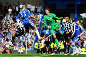 Alex of Chelsea scores his sides second goal as Tim Krul the Newcastle United goalkeeper fails to claim the ball during the Barclays Premier League...