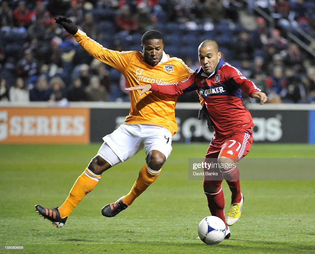 Alex #71 of Chicago Fire and <a gi-track='captionPersonalityLinkClicked' href=/galleries/search?phrase=Jermaine+Taylor+-+Soccer+Player&family=editorial&specificpeople=13524207 ng-click='$event.stopPropagation()'>Jermaine Taylor</a> #4 of Houston Dynamo fight for the ball in an MLS match on October 31, 2012 at Toyota Park in Bridgeview, Illinois. The Houston Dynamo defeated the Chicago Fire 2-1.