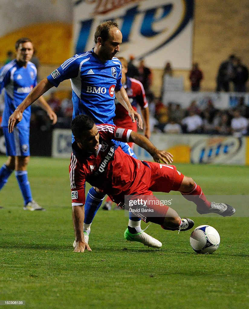 Alex of Chicago Fire is taken down by Justin Mapp of the Montreal Impact in an MLS match on September 15 2012 at Toyota Park in Bridgeview Illinois...