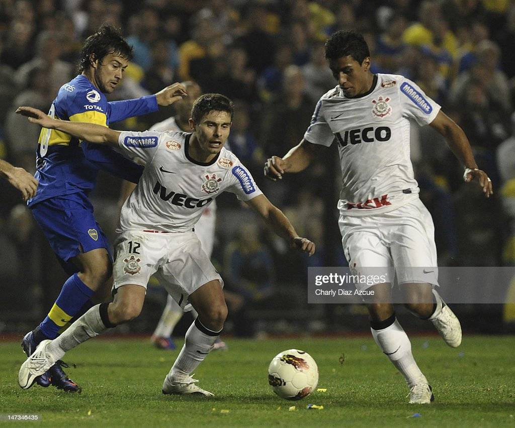 Alex of Corinthians struggles for the ball during a match between Boca Juniors and Corinthians as part of the finals of the Copa Libertadores 2012 at Bombonera Stadium on June 27, 2012 in Buenos Aires, Argentina.