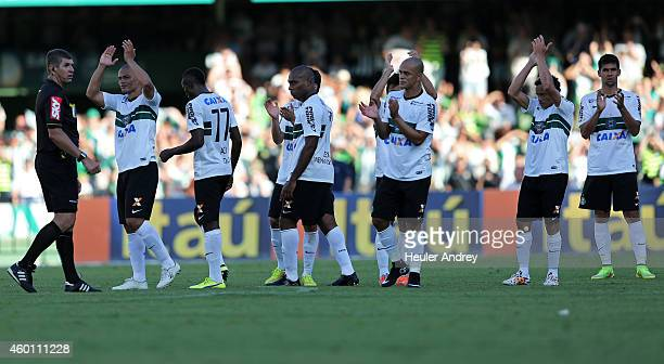 Alex of Coritiba leaves the pitch in his farewell as a football player during the match between Coritiba and Bahia for the Brazilian Series A 2014 at...