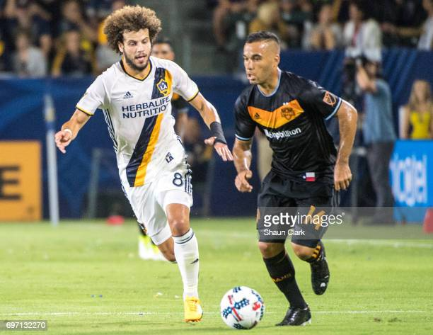 Alex of Houston Dynamo is chased by Joao Pedro of Los Angeles Galaxy during the Los Angeles Galaxy's MLS match against Houston Dynamo at the StubHub...
