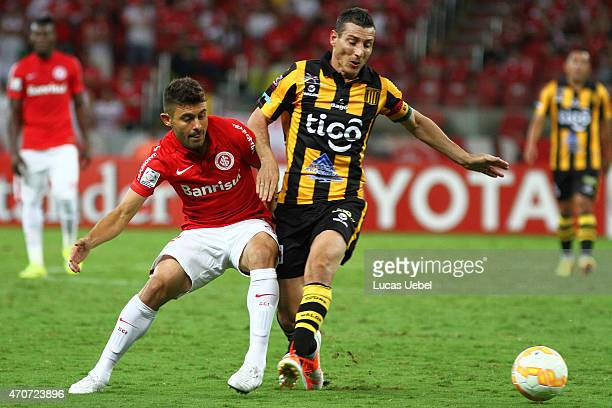 Alex of Internacional battles for the ball against Pablo Escobar of The Strongest during match between Internacional and The Strongest as part of...