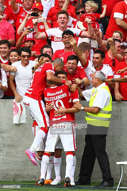 Alex of Internacional celebrates their first goal with the fans during the match between Internacional and Botafogo as part of Brasileirao Series A...