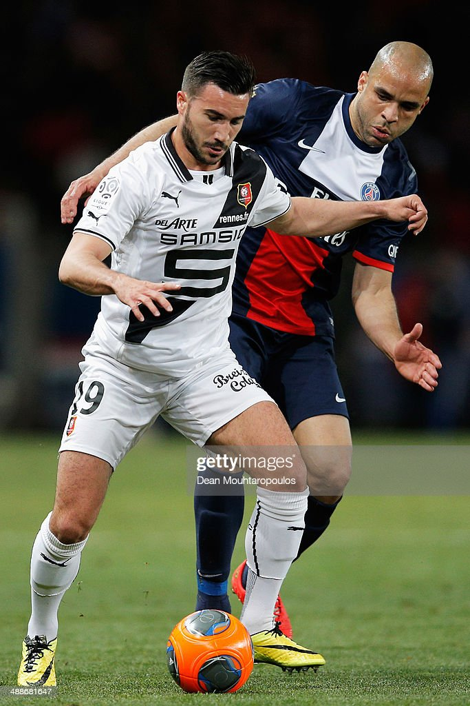 Alex of PSG and <a gi-track='captionPersonalityLinkClicked' href=/galleries/search?phrase=Romain+Alessandrini&family=editorial&specificpeople=9572619 ng-click='$event.stopPropagation()'>Romain Alessandrini</a> of Rennes battle for the ball during the Ligue 1 match between Paris Saint-Germain FC and Stade Rennais FC at Parc des Princes on May 7, 2014 in Paris, France.