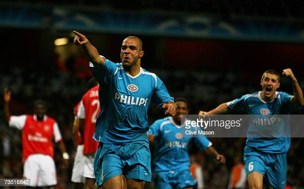 Alex of PSV celebrates after scoring his team's equalising goal during the UEFA Champions League round of sixteen second leg match between Arsenal...