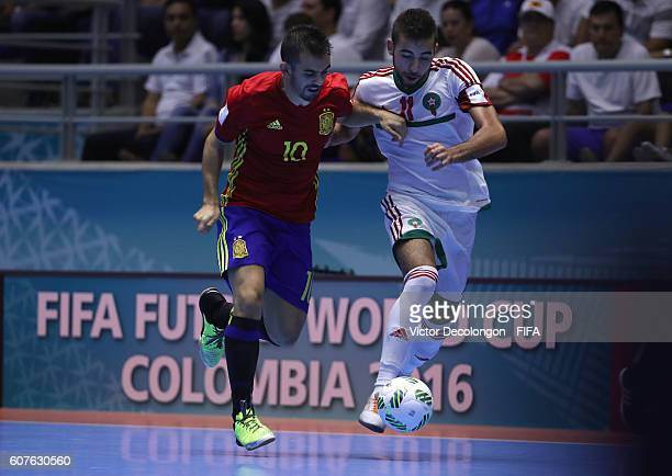 Alex of Spain and Bilal Bakkali of Morocco vie for the ball during Group F match play between Spain and Morocco in the 2016 FIFA Futsal World Cup at...