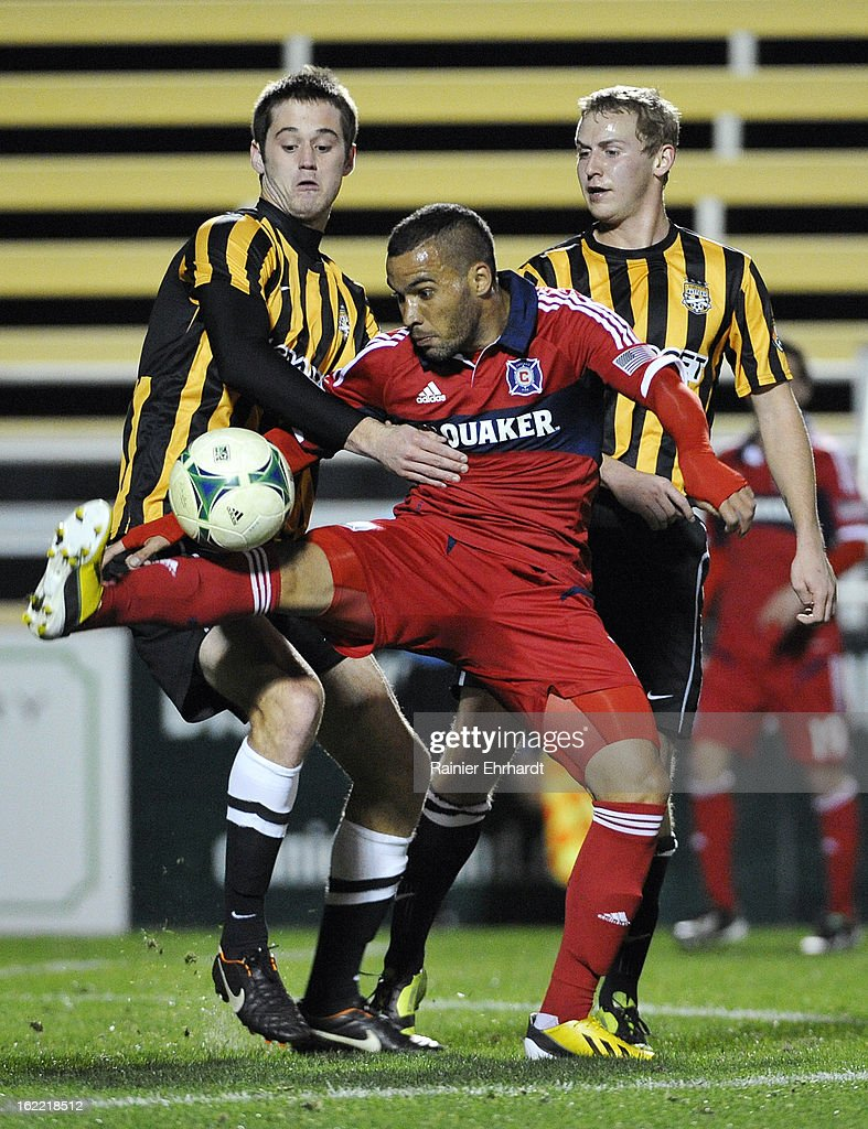 Alex #71 of the Chicago Fire battles for the ball with Sean Ferguson #6 of the Charleston Battery and teammate Tommy Catalano #15 during the second half of a game at Blackbaud Stadium on February 20, 2013 in Charleston, North Carolina.