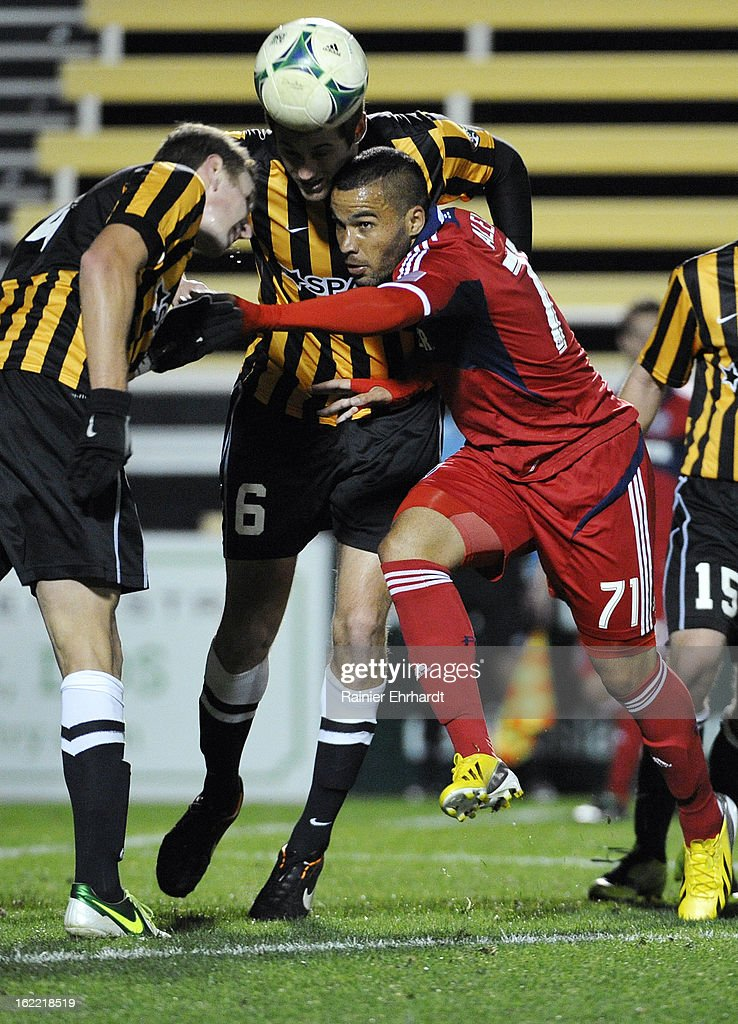 Alex #71 of the Chicago Fire battles for the ball with Taylor Mueller #4 of the Charleston Battery and teammate Sean Ferguson #6 during the second half of a game at Blackbaud Stadium on February 20, 2013 in Charleston, North Carolina.