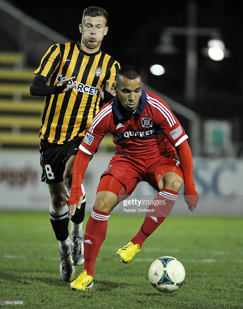 Alex #71 of the Chicago Fire dribbles the ball as Nicki Paterson #8 of the Charleston Battery defends during the second half of a game at Blackbaud Stadium on February 20, 2013 in Charleston, North Carolina.