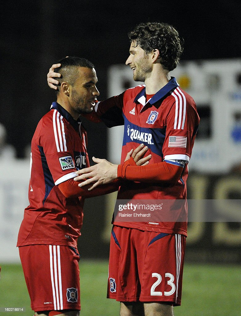 Alex #71 of the Chicago Fire is congratulated by teammate Arne Friedrich #23 after scoring the game-winning goal against the Charleston Battery during the second half of a game at Blackbaud Stadium on February 20, 2013 in Charleston, North Carolina.