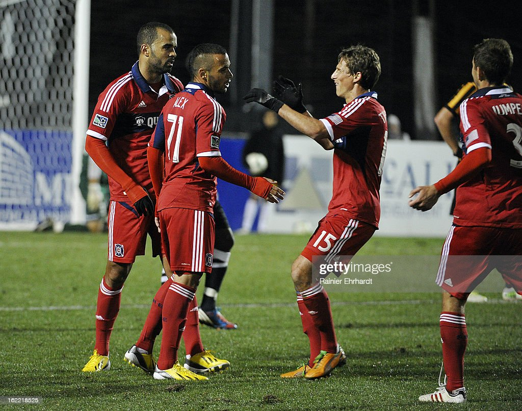 Alex #71 of the Chicago Fire is congratulated by teammates Wells Thompson #15, Maicon Santos #29 and Hunter Jumper #3 after scoring the game-winning goal against the Charleston Battery during the second half of a game at Blackbaud Stadium on February 20, 2013 in Charleston, North Carolina.