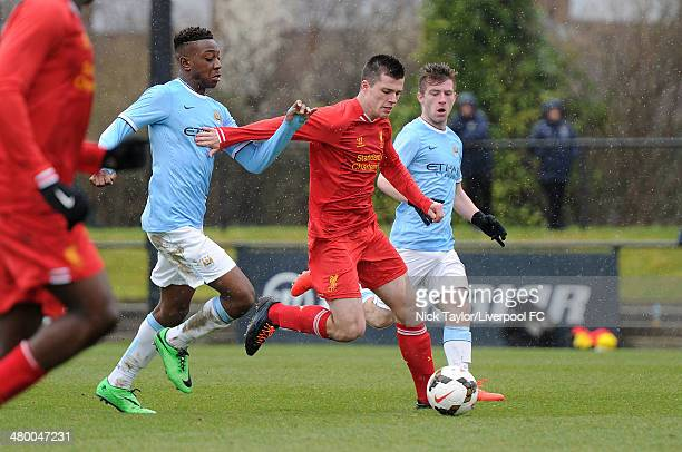 Alex O'Hanlon of Liverpool and Denziel Boadu of Manchester City in action during the Barclays Premier League Under 18 fixture between Liverpool and...