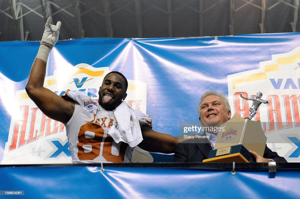 Alex Okafor #80 of the University of Texas Longhorns celebrates as Defensive Player of the game against the Oregon State Beavers in the Valero Alamo Bowl at the Alamodome on December 29, 2012 in San Antonio, Texas. Texas won the game 31-27.