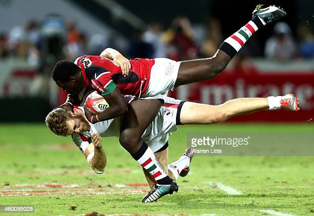 Alex Olaba of Kenya tackles Conor Trainor of Canada during day two of the Emirates Dubai Sevens HSBC Sevens World Series at The Sevens Stadium on...