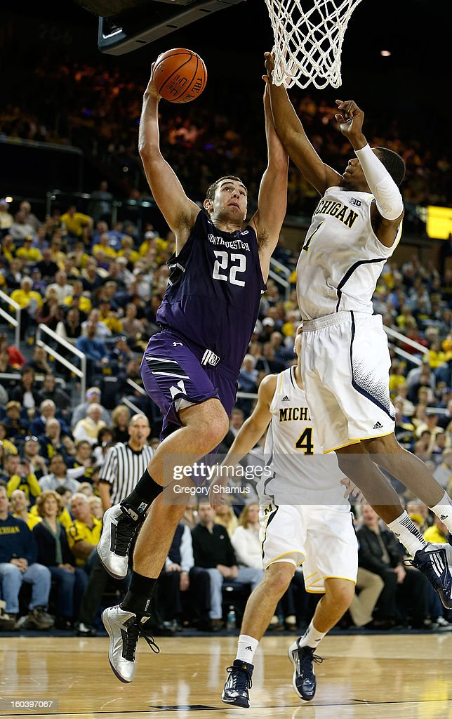Alex Olah #22 of the Northwestern Wildcats tries to get to the basket in the second half past Glenn Robinson III #1 of the Michigan Wolverines at Crisler Center on January 30, 2013 in Ann Arbor, Michigan. Michigan won the game 68-46.