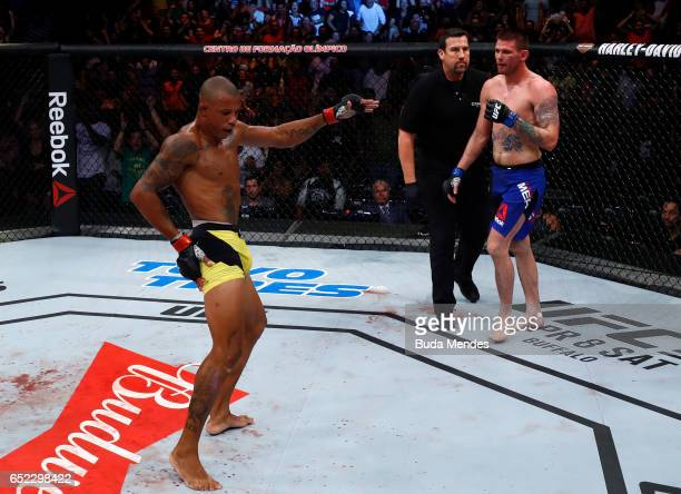 Alex Oliveira of Brazil celebrates after his submission victory over Tim Means in their welterweight bout during the UFC Fight Night event at CFO...