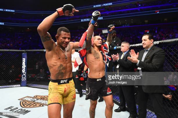 Alex Oliveira of Brazil congratulates Yancy Medeiros after Medeiros won by TKO in their welterweight bout during the UFC 218 event inside Little...