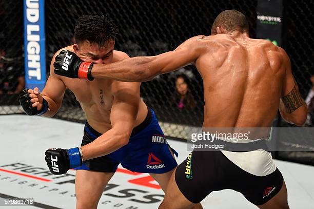 Alex Oliveira of Brazil punches James Moontasri in their welterweight bout during the UFC Fight Night event at the United Center on July 23 2016 in...