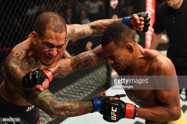 Alex Oliveira of Brazil punches Yancy Medeiros in their welterweight bout during the UFC 218 event inside Little Caesars Arena on December 02 2017 in...