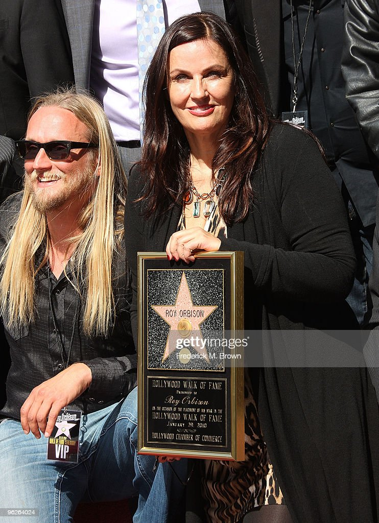 Alex Orbison (L) and Barbara Orbison pose for photographers during the installing ceremonies for recording artist Roy Orbison at the Hollywood Walk of Fame on January 29, 2010 in Hollywood, California.
