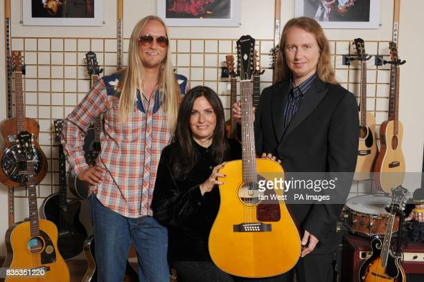 Alex Orbison Barbara Orbison and Roy Orbison jnr are seen with the new Roy Orbison Limited Edition Epiphone 'Pretty Woman' 12 string acoustic guitar...