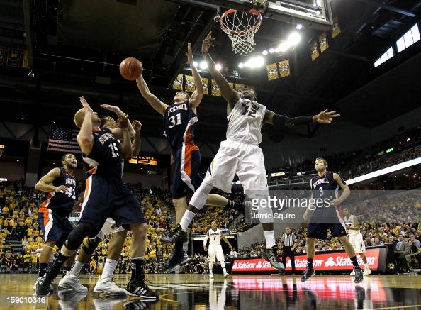 Alex Oriakhi of the Missouri Tigers battles Mike Muscala of the Bucknell Bison for a rebound during the game at Mizzou Arena on January 5 2013 in...