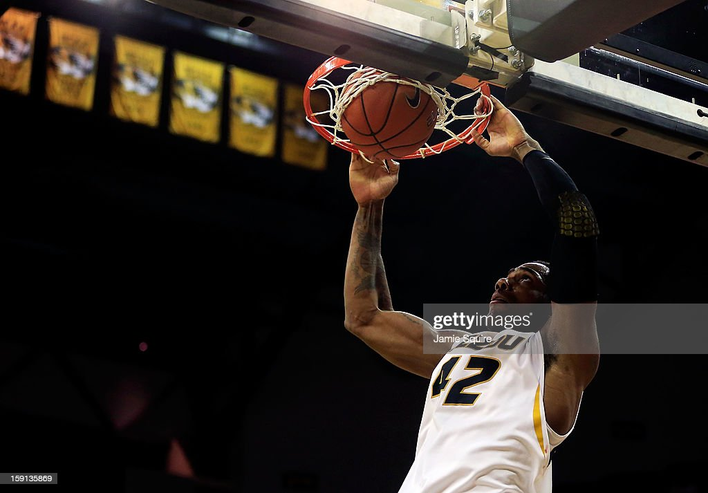 Alex Oriakhi #42 of the Missouri Tigers dunks during the game against the Alabama Crimson Tide at Mizzou Arena on January 8, 2013 in Columbia, Missouri.