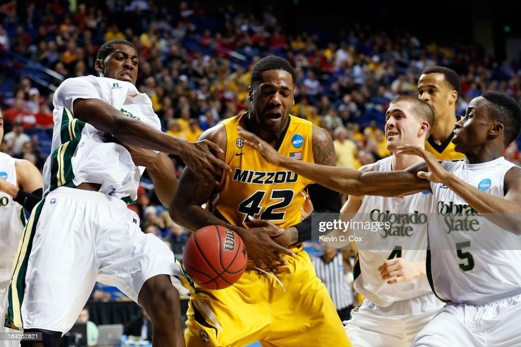 Alex Oriakhi of the Missouri Tigers fights for the loose ball against Gerson Santo Pierce Hornung and Jon Octeus of the Colorado State Rams during...