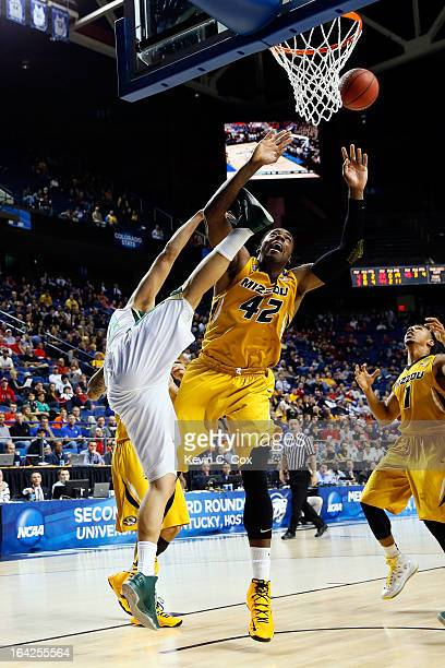 Alex Oriakhi of the Missouri Tigers fouls Dorian Green of the Colorado State Rams while going after the ball during the second round of the 2013 NCAA...