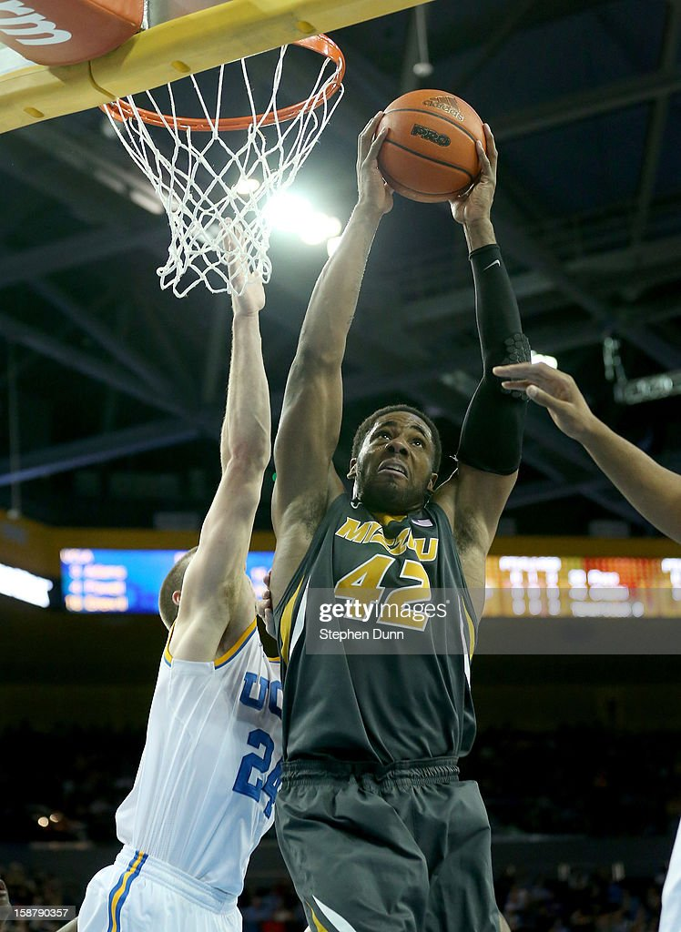 Alex Oriakhi #42 of the Missouri Tigers grabs a rebound against Travis Wear #24 of the UCLA Bruins at Pauley Pavilion on December 28, 2012 in Los Angeles, California. UCLA won 97-94 in overtime.