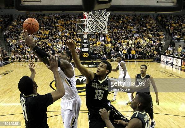 Alex Oriakhi of the Missouri Tigers grabs a rebound as Sheldon Jeter and Kevin Bright of the Vanderbilt Commodores defend during the game at Mizzou...