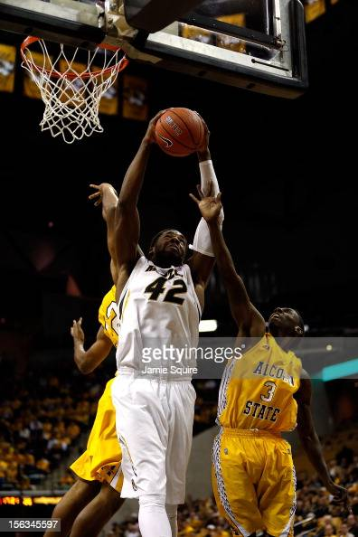 Alex Oriakhi of the Missouri Tigers grabs a rebound while Anthony Evans of the Alcorn State Braves defends during the game at Mizzou Arena on...