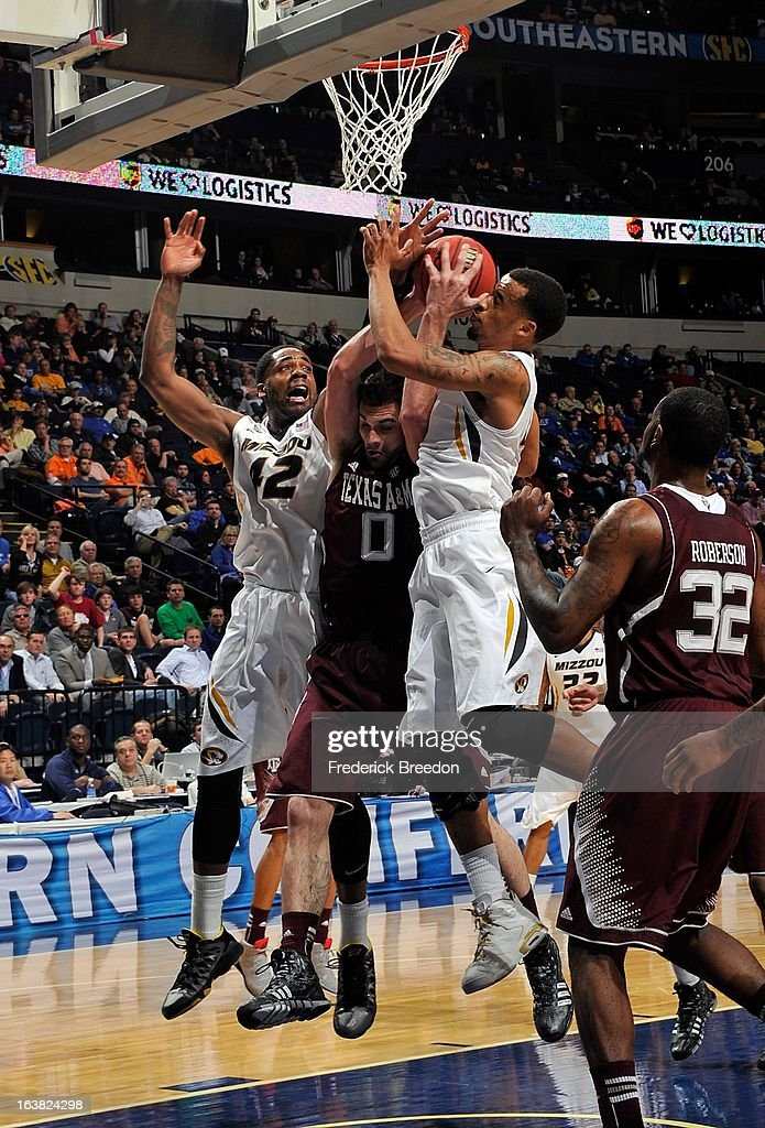 Alex Oriakhi #42 of the Missouri Tigers plays against Andrew Young #00 of the Texas A&M Aggies during the second round of the SEC Men's Basketball Tournament at the Bridgestone Arena on March 14, 2013 in Nashville, Tennessee.