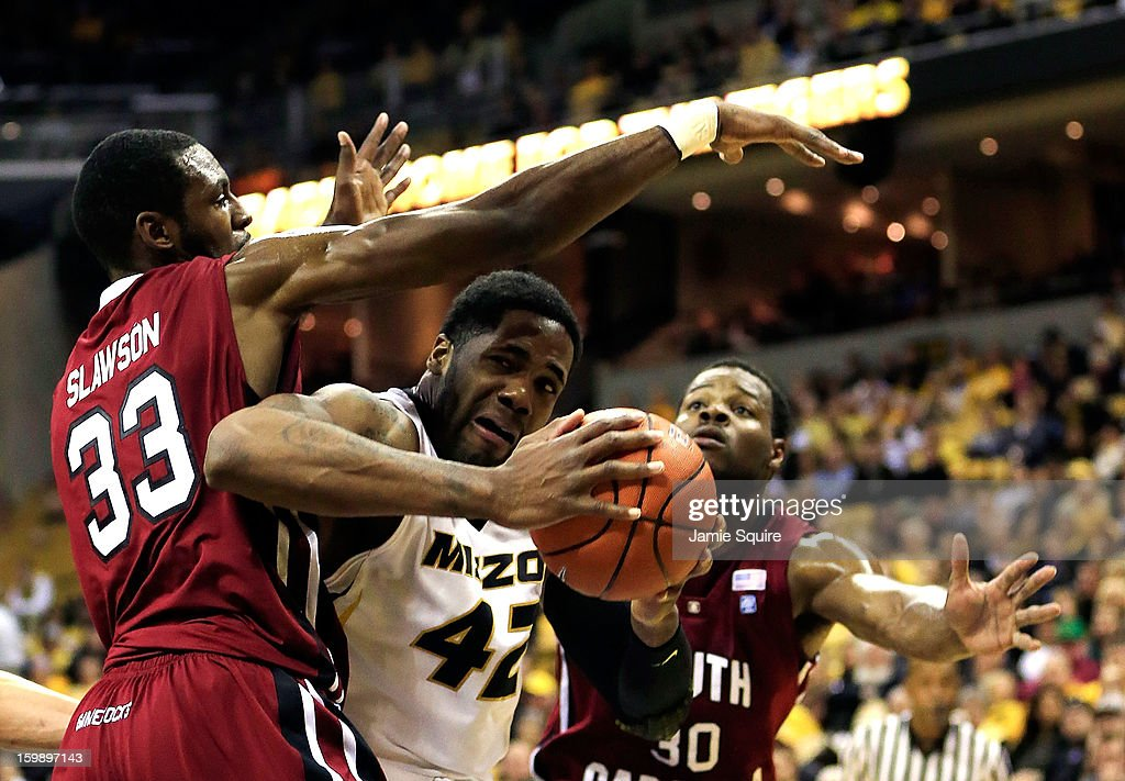 Alex Oriakhi #42 of the Missouri Tigers tries to score as RJ Slawson #33 and Lakeem Jackson #30 of the South Carolina Gamecocks defend during the game at Mizzou Arena on January 22, 2013 in Columbia, Missouri.