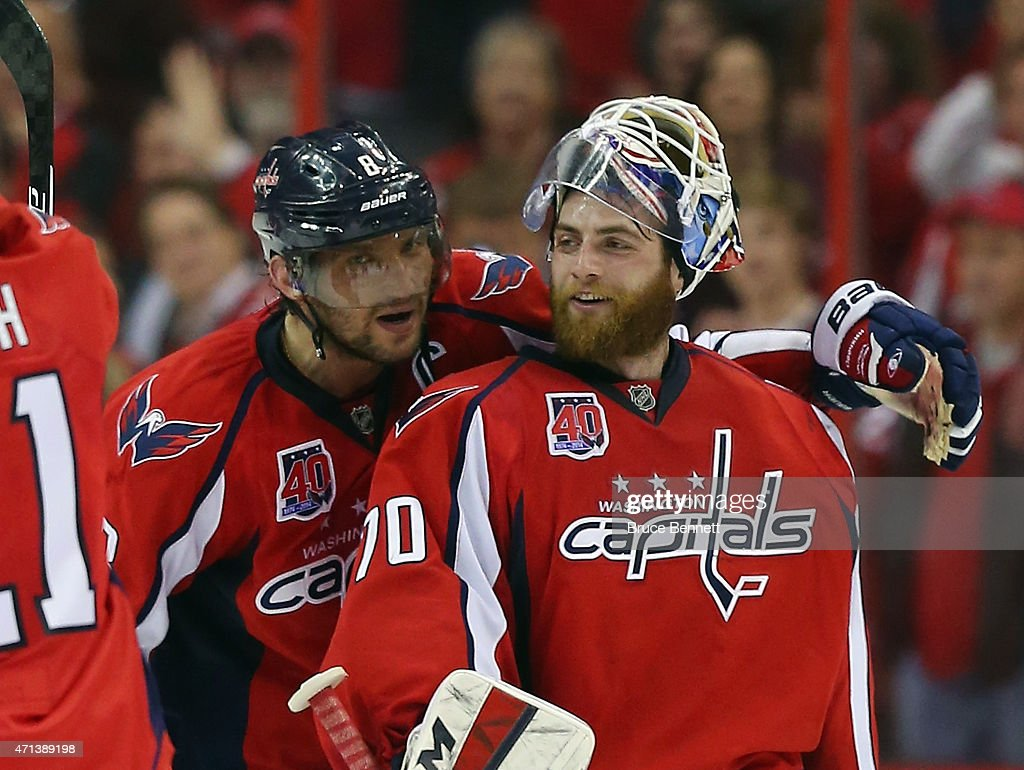 Alex Ovechkin #8 and <a gi-track='captionPersonalityLinkClicked' href=/galleries/search?phrase=Braden+Holtby&family=editorial&specificpeople=5370964 ng-click='$event.stopPropagation()'>Braden Holtby</a> #70 of the Washington Capitals celebrate their 2-1 victory over the New York Islanders in Game Seven of the Eastern Conference Quarterfinals during the 2015 NHL Stanley Cup Playoffs at Verizon Center on April 27, 2015 in Washington, DC. The Capitals defeated the Islanders 2-1 to win the series 4 games to 3.