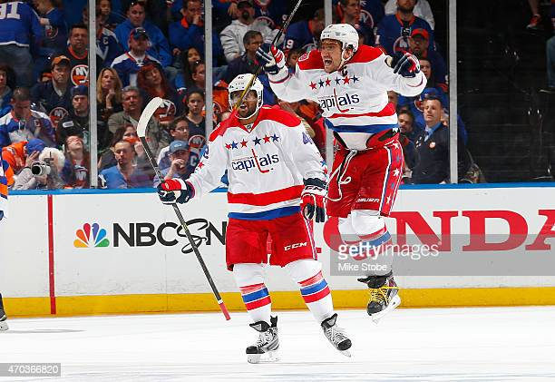 Alex Ovechkin and Joel Ward of the Washington Capitals celebrate a goal by teammate Nicklas Backstrom during the game against the New York Islanders...