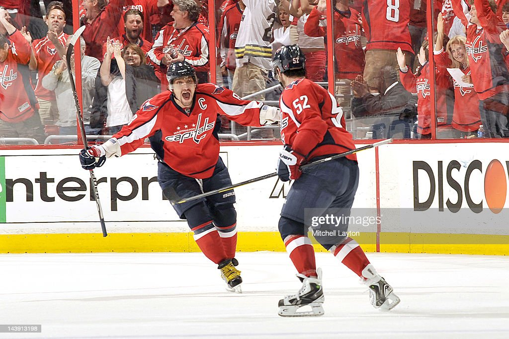 Alex Ovechkin #8 and Mike Green #52 of the Washington Capitals celebrate their third goal during the third period of Game Four of the Eastern Conference Semifinals of the 2012 NHL Stanley Cup Playoffs against the New York Rangers on May 5, 2012 at the Verizon Center in Washington, DC.
