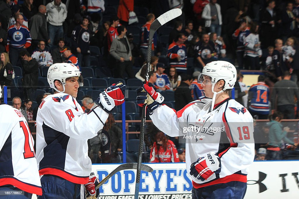 Alex Ovechkin #8 and Nicklas Backstrom #19 of the Washington Capitals celebrate after winning the game against the Edmonton Oilers on October 24, 2013 at Rexall Place in Edmonton, Alberta, Canada.