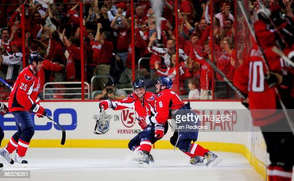 Alex Ovechkin and Sergei Fedorov of the Washington Capitals celebrate Fedorov's game winning goal against the New York Rangers during Game Seven of...