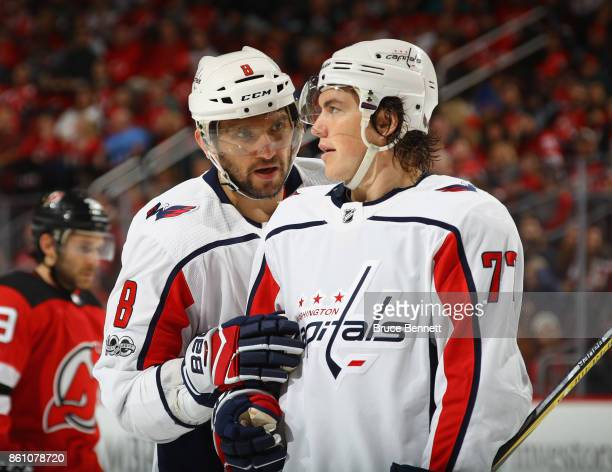 Alex Ovechkin and TJ Oshie of the Washington Capitals confer during the game against the New Jersey Devils at the Prudential Center on October 13...