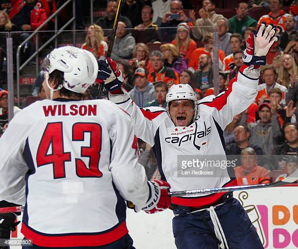 Alex Ovechkin and Tom Wilson of the Washington Capitals celebrate a second period goal against the Philadelphia Flyers by teammate Jason Chimera on...