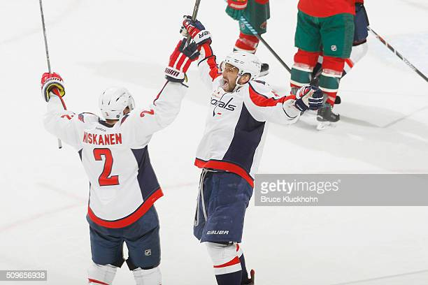 Alex Ovechkin celebrates after scoring a hattrick with his Washington Capitals teammate Matt Niskanen during the game against the Minnesota Wild on...
