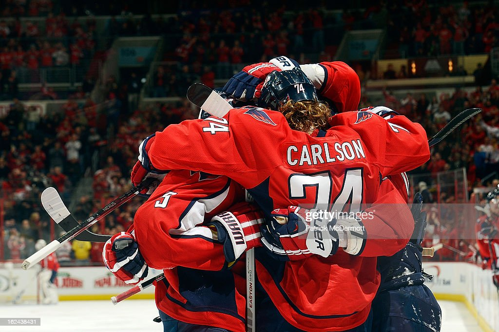 Alex Ovechkin #8 celebrates with John Erskine #4 and John Carlson #74 of the Washington Capitals after scoring a goal during the second period of an NHL game against the New Jersey Devils at Verizon Center on February 23, 2013 in Washington, DC.